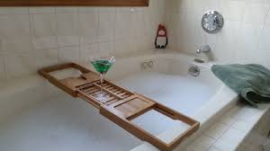enjoy happy hour using deluxe bamboo bathtub caddy with built in wine glass holder