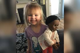 Toddler defends her choice of doll to confused Target cashier.