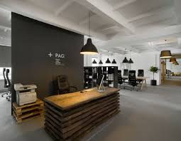 office studio design. Pride Interactive Office By Morpho Studio - Dezeen; Great Use Of Pallets For The Industrial Look. Pairing It With Matte Black Wall Gives Design C