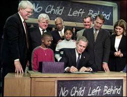 nclb turns education week president george w bush seated signs the no child left behind legislation into
