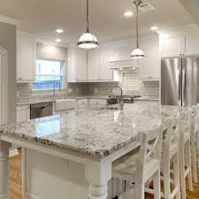white granite countertops and glass subway tile backsplash -- dark wood  floors would make it