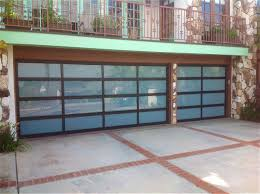 These Modern Sleek Garage Doors Perfectly Mirror The Clean Lines And Glass Expanses Of Your Homeu0027s Contemporary Design Available In A Variety
