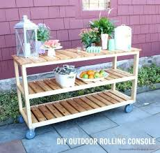 a diy tutorial to build an outdoor rolling console great for serving food and drinks plus plenty of open shelf storage for your patio or backyard space