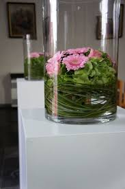 Flowers and grass inside of vase. We can add LED light so they light up too.