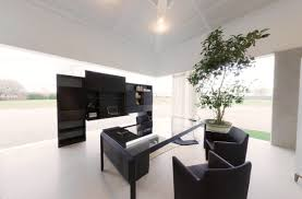 contemporary office spaces. Modern Black Office Space With Juvenille Tree In Pot And Glass Table Contemporary Spaces