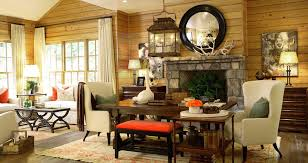 Rustic Country Living Room Idea With Lantern Chandelier Feat Wingback  Chairs Plus Stone Fireplace Also Round