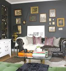 I have charcoal walls in my living room and the idea that dark colors make  a space seem smaller isn't true.