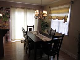 ravishing white dining room curtains for sliding glass door curtains added homemade over valance as well as bronze chandelier over black wooden dining table