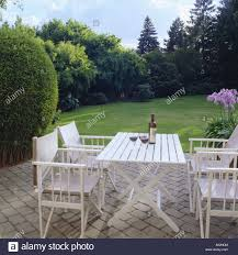 white garden furniture. White Garden Furniture On Paved Patio Overlooking Lawn In Large Country I