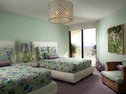 breathtaking bedroom with twin bedspreads drum chandelier and bedroom wall paint with upholstered bed also