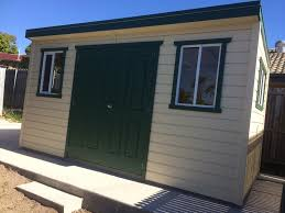 garden shed with windows and double doors