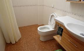 stylish small bathroom designed with modern fixtures and cork flooring cork flooring in bathroom decor