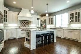 off white painted kitchen cabinets white kitchen cabinets with wood floors traditional kitchen with off white
