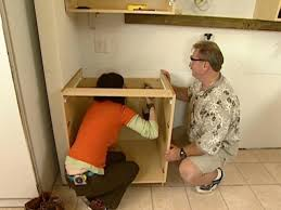 step 4 secure cabinets into wall studs