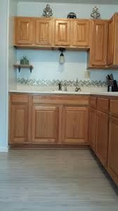 white countertop with oak cabinets