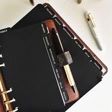 black foiled dividers inside an louis vuitton desk agenda monogram lv da i love