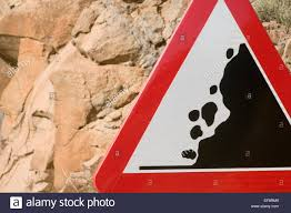 falling rock rocks road sign signs roadsign roadsigns rolling stone stones cliff cliffs warning warn red