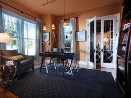 decoration black accent on wide pattern carpet beside big book storage facing grey single sofa blue office decor