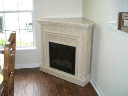 interior white granite fireplace mantel of corner fireplace having black metal fire box on white
