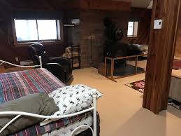 basement hot tub. Lanark Highlands Cabin Rental - Basement Living Area With Woodstove And Beds. Hot Tub