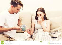 Men And Women In Bedroom Couple Care Sick Woman Blowing Her Nose Man Take A Cup With Hot