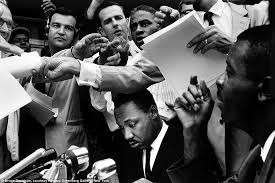 Iconic: In 1962, Davidson photographed Martin Luther King Jr (center)  during the