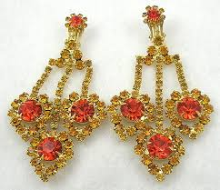 description delizza elster rhinestone chandelier clip earrings each of the three large golden topaz rhinestone drops have a large hyacinth orange