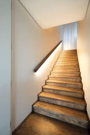 the staircase and the upstairs flooring is oiled oak led lighting under the handrail gives