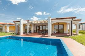 luxury home swimming pools. Stock Photo - Swimming Pool Outside Luxury Home Pools
