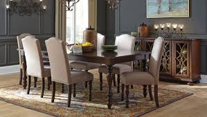 made with birch veneers and hardwood solids finished in a warm brown finish chairs and barstools are upholstered in a light brown textured fabri