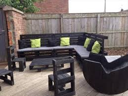 pallet furniture patio. Wooden Terrace With Chairs Mattresses And Furniture In Black Inside The Fence Pallet Patio N