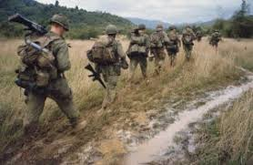 i didn t understand the vietnam war until i met my father in law   iers are walking through a muddy field in vietnam on a search and destroy operation