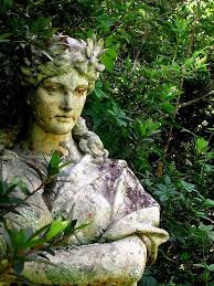 a statue in the forest garden statues