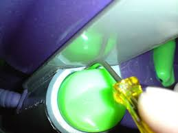 repairing removing the cable switch on a dyson dc04 or similar at the same time pull on the button so that it is up in the off position and push the screwdriver handle up this should depress the catch that is