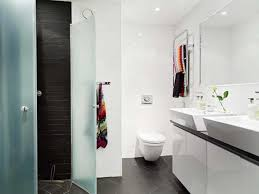 apartment bathrooms. Fabric Sea Theme Curtains Covering Bathub Small Apartment Bathrooms Brown Wooden Varnished Vanity Cabinet Gray Ceramic Laminate Floor White Oval Soaking