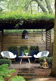 Zen garden furniture Wooden Deck Zen Garden Features Pergola Over Pair Of White Modern Chairs And Outdoor Accent Table Placed Before Three Black Planters Pinterest Zen Garden Features Pergola Over Pair Of White Modern Chairs And