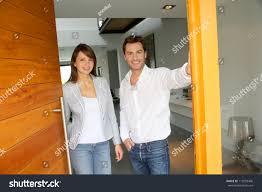 opening front door. Couple Opening The Front Door Of Their Home