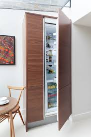 Integrated Fridge with plastic acrylic oven and microwave cabinets3-  kitchen contemporary and white walls