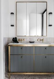 art deco bathroom. A Corrugated Metal Vanity With Brass Touches Looks Very Bold And Interesting, Art Deco Though Bathroom O