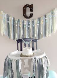 reused my fabric bunting from my baby shower and made a matching highchair banner diy one cake topper and 1 flag