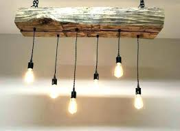 gray wood and iron valencia chandelier gray wood and iron chandelier reclaimed barn sleeper beam light fixture with led world market gray wood and iron