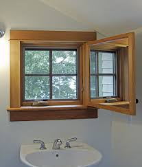bathroom window. Open The Door, And A Crank-out Casement Window Offers An Outdoor View, Daylight, Ventilation.Robert Knight. Bathroom