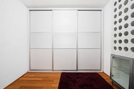 sliding wardrobe doors within a frame