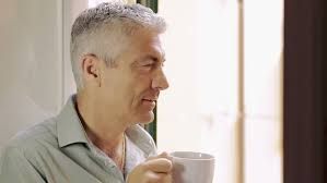 Young couple drinking coffee in the morning and laughs at his home. Handsome Man Looking Outside At Stock Footage Video 100 Royalty Free 6706477 Shutterstock