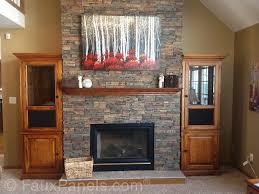 the faux stone paneling on this fireplace surround transforms an otherwise plain drywall surround for a