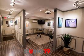 studio track lighting. if you take away the comfy couches chairs and bistro tablesu2026 this is a fullblown art gallery complete with professional hanging track lighting studio e