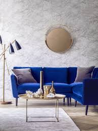 living room ideas with blue sofa. blue velvet sofa (holly corner sofa) with a gold coffee table and marble walls living room ideas