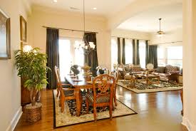 Living Dining Room Long Brown Wooden Dining Table With Black Plastic Chairs With