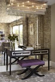 A feature wall in antique mirror glass/ Love the desk & the chandelier <3