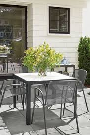 create an outdoor dining area with our crescent table bar cart and rio outdoor chairs